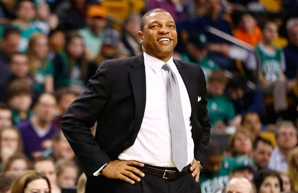 Celtics head coach Doc Rivers smiles as he