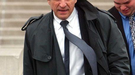 Attorney Raymond G. Perini leaves U.S. District Court
