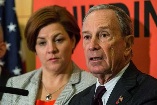 New York City Mayor Michael Bloomberg (R) and
