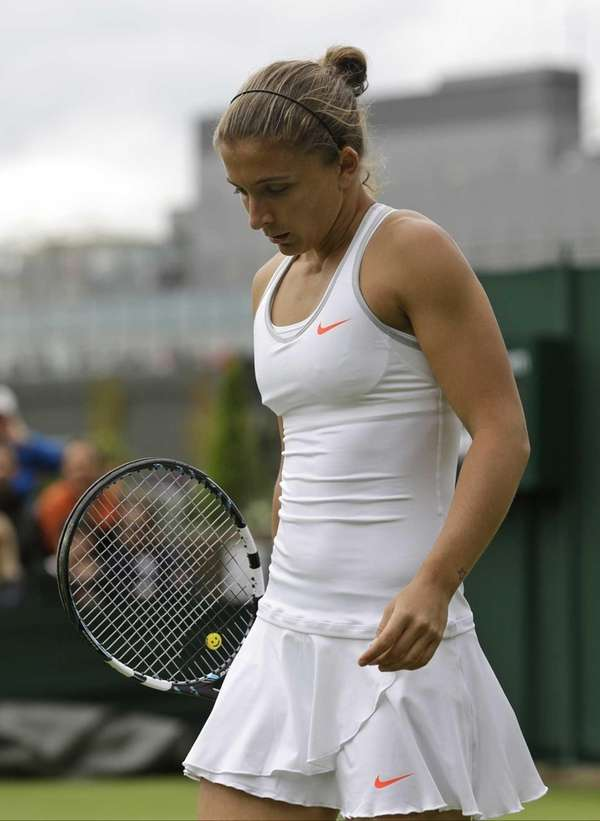 Sara Errani of Italy walks back to her