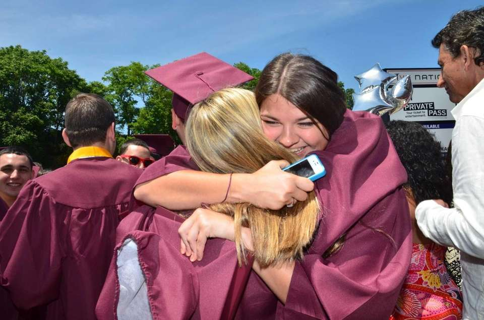 Two Wellington C. Mepham High School graduates hug