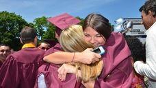 Two Wellington C. Mepham High School graduates hug