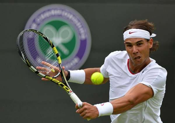 Rafael Nadal of Spain hits a return against