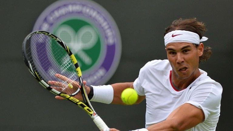 Rafael Nadal of Spain hits a return against