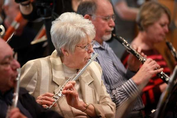 Jan MacDonald, 78, of Huntington, plays the flute