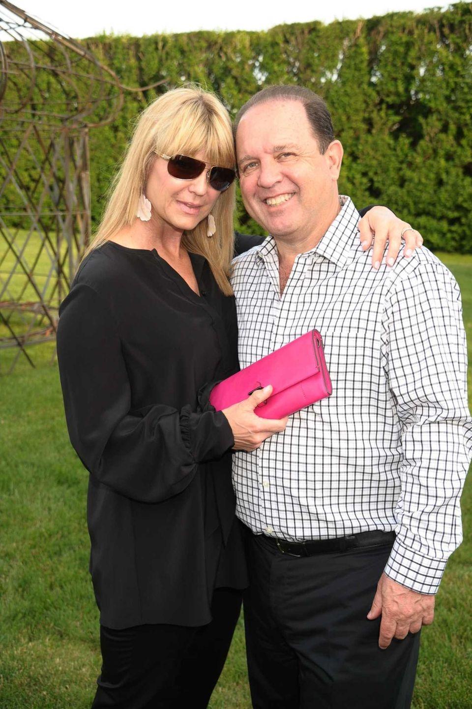 Marcy Warren and Michael Warren attend the