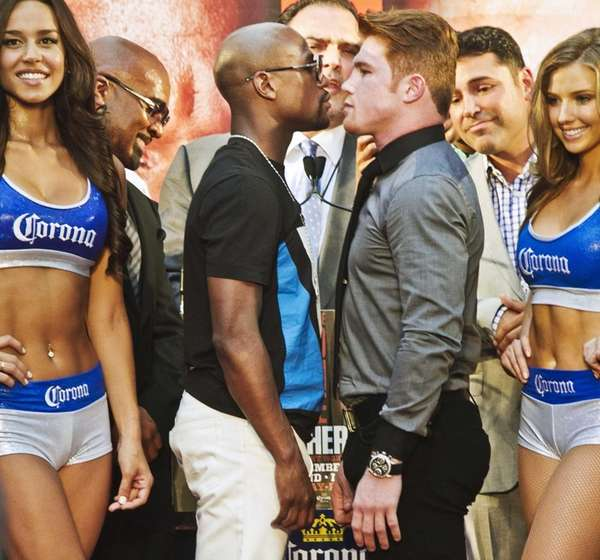 Floyd Mayweather poses in a face-off with Saul