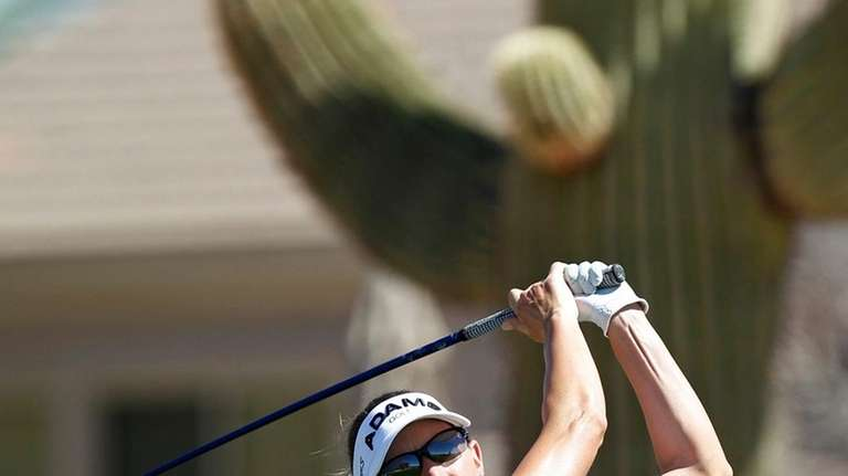 Brittany Lang hits off the eighth tee during