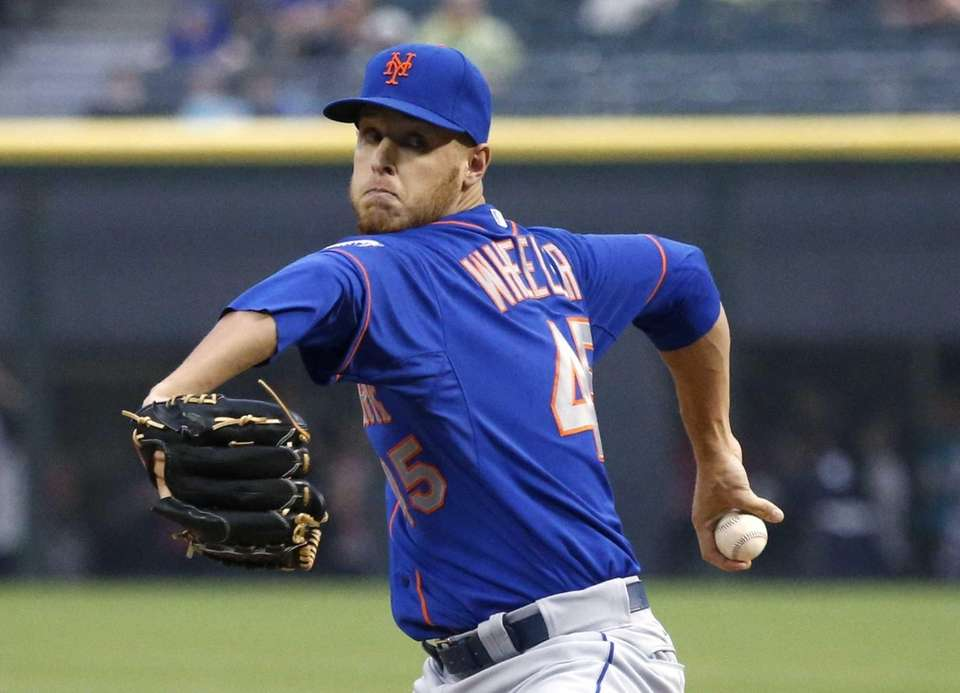 Mets starting pitcher Zack Wheeler winds up during
