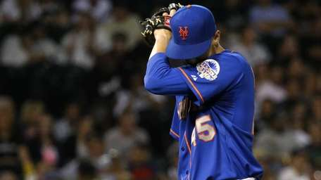 Mets starting pitcher Zack Wheeler leaves the game