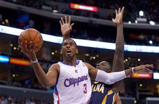 Los Angeles Clippers guard Chris Paul, left, puts