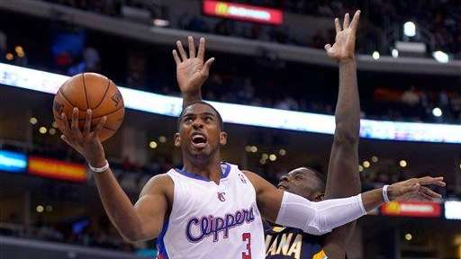 Los Angeles Clippers guard Chris Paul, left, puts