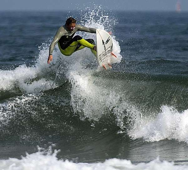 A surfer negotiates the waves at Lido Beach.