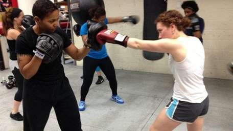 Teresa Scott teaches women the fundamentals of boxing.