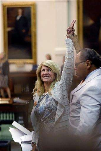 Texas State Sen. Wendy Davis, D-Fort Worth, left,