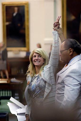 Texas State Sen. Wendy Davis, D-Fort Worth, left,