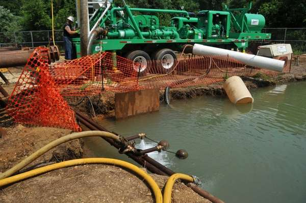 Drillers work at a new well site near