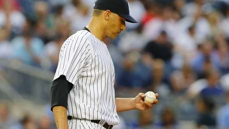 Andy Pettitte of the Yankees looks at the