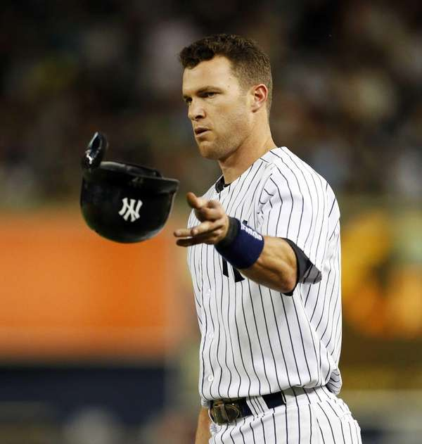 Jayson Nix of the Yankees tosses his helmet