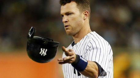 Jayson Nix of the Yankees tosses his helmet