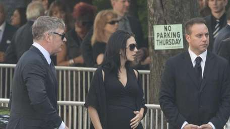 Alec Baldwin, left, and his wife Hilaria attend