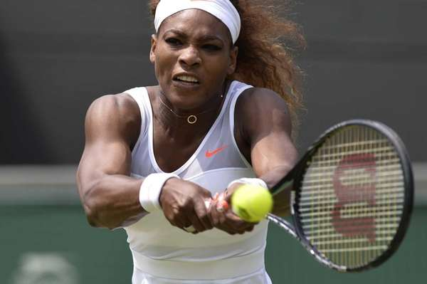 Serena Williams returns against France's Caroline Garcia during