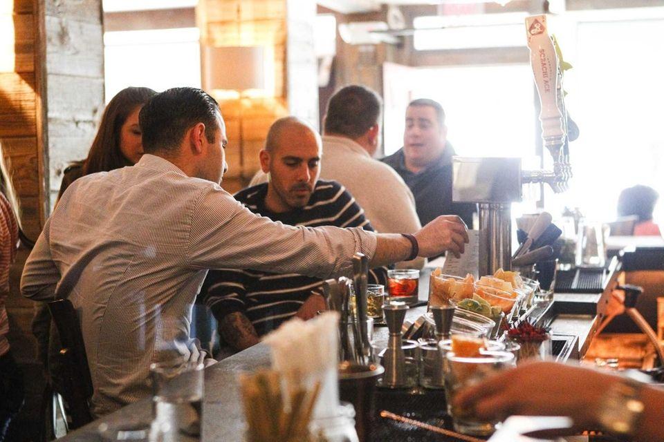 Patrons linger at the bar at The Cuddy,