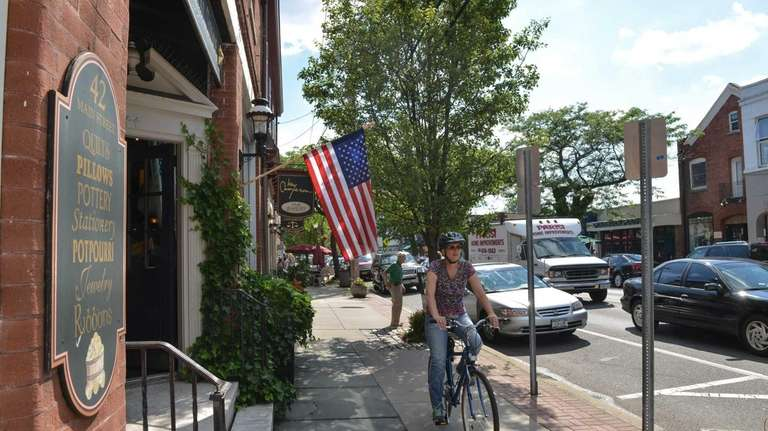 A cyclist takes a spin down Sayville's Main