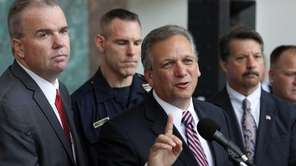 Nassau County Executive Ed Mangano speaks beside Nassau