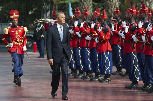 President Barack Obama reviews an honor guard outside
