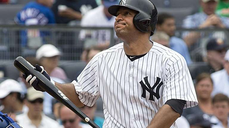 Yankees hitter Vernon Wells reacts after striking out
