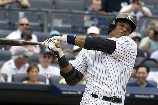 Yankees hitter Robinson Cano strikes out during the