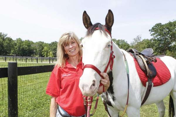 Julie Dell'Aira, a coordinator of community therapeutic riding