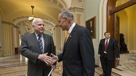 Sen. John McCain, R-Ariz., left, and Sen. Charles