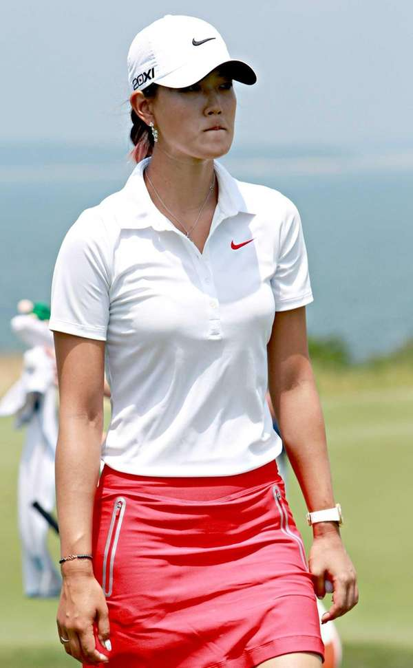 Michelle Wie leaves the ninth hole at the