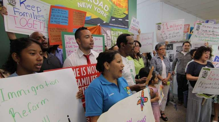 Long Island immigrants and their allies chant during
