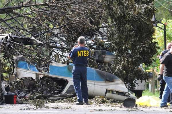 An official examines the wreckage Aug. 20, the