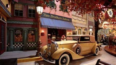 A 1934 Packard Eight Convertible sits on display