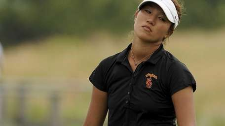 Annie Park reacts after missing a putt on