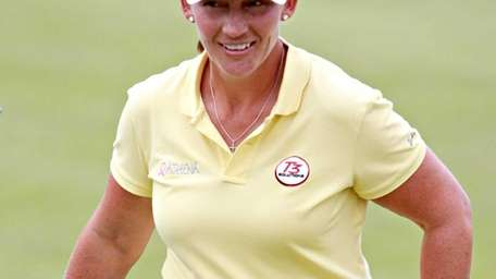 Angela Stanford leaves the 18th green after finishing