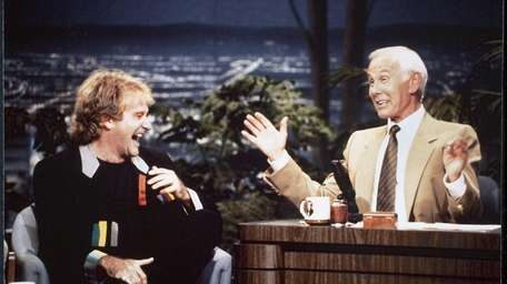 Robin Williams, left, with host Johnny Carson during