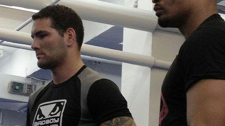 UFC fighters Chris Weidman, left, and David Branch