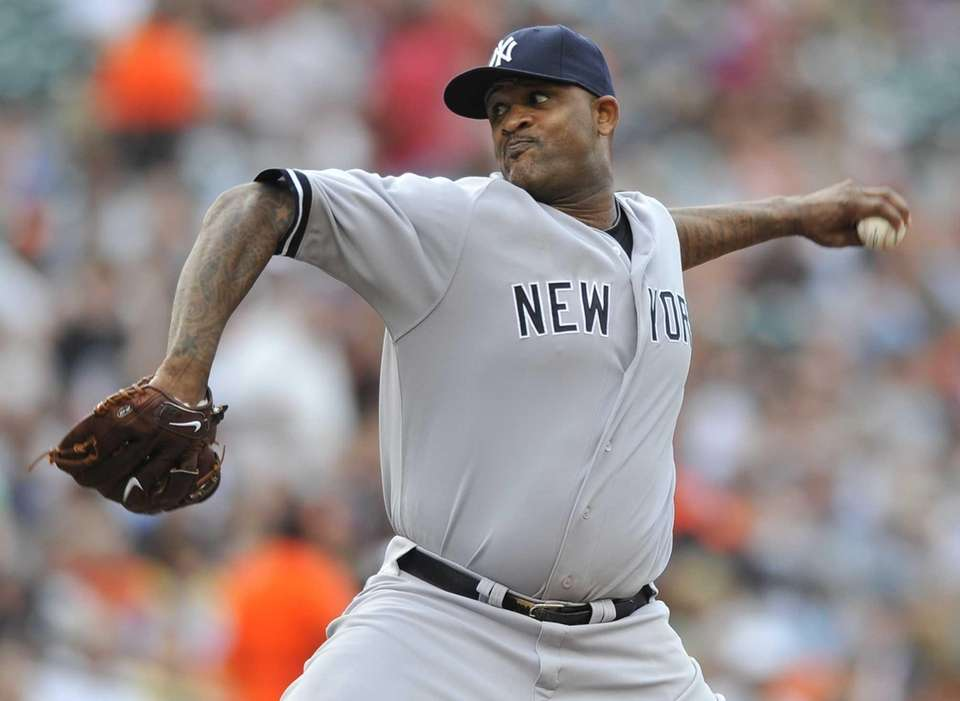 Yankees starting pitcher CC Sabathia delivers against the