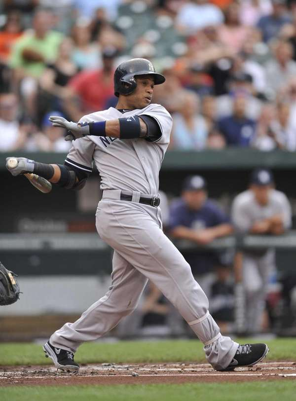 Yankees' Robinson Cano follows through on an RBI