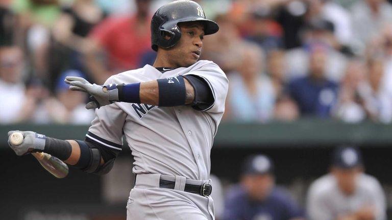 Yankees' Robinson Cano follows through on an RBI