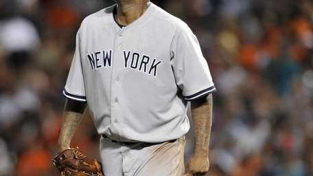 Yankees pitcher CC Sabathia reacts after giving up
