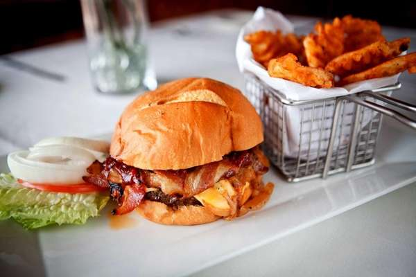 Burger and fries at Studio Grille in Selden,