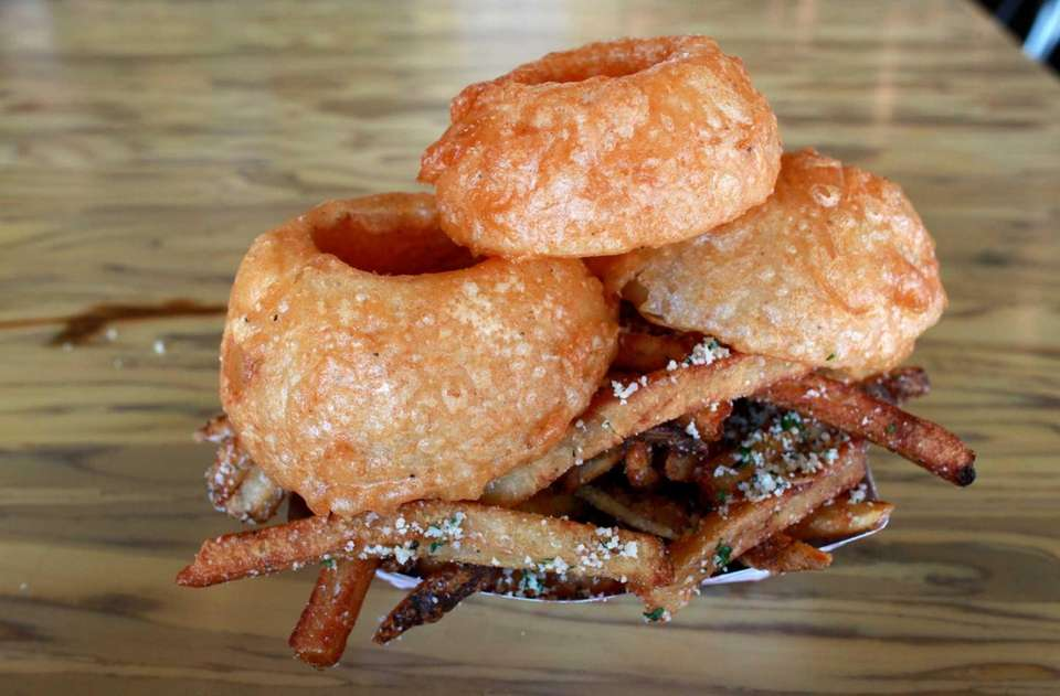 Onion rings and fries are side stars at