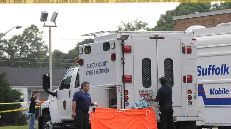 Suffolk County police investigate the shooting of a