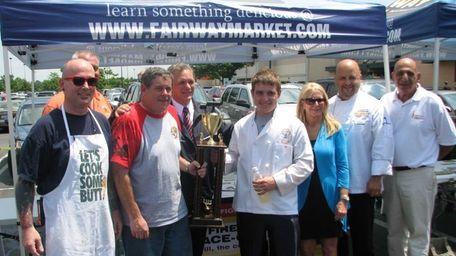 Nassau County Executive Edward Mangano, center, celebrates with